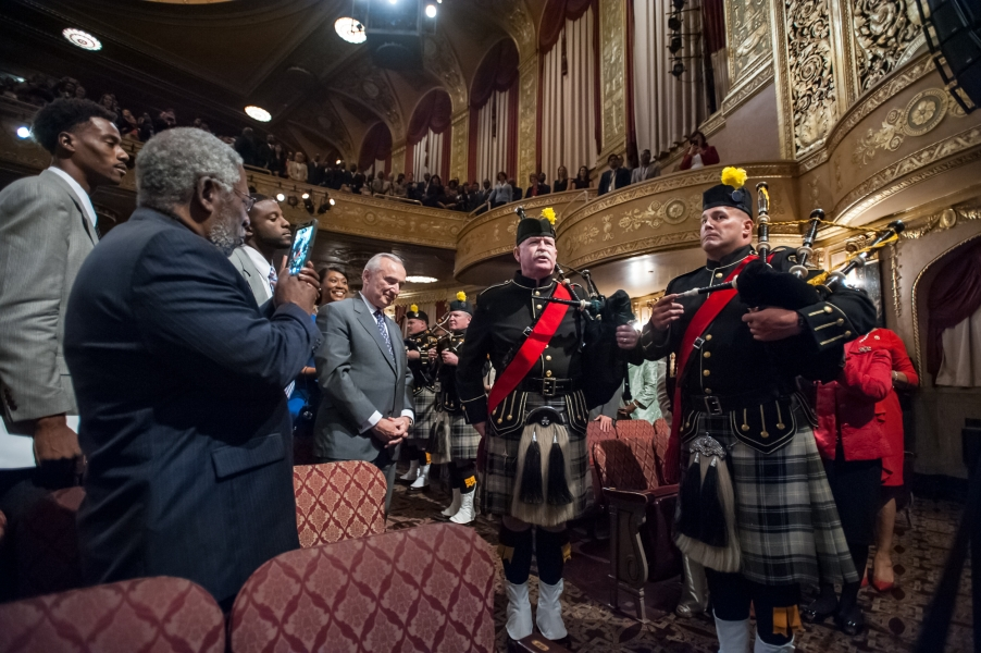 The DEA Black & Gold Pipes & Drums Band salutes Attorney General Loretta Lynch
