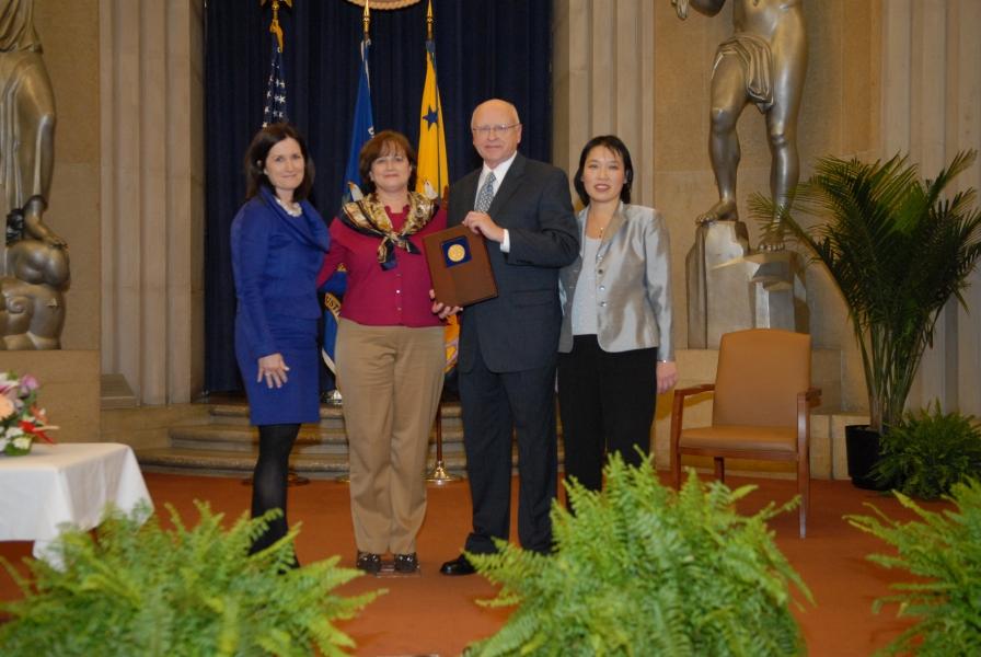 Assistant AG Christine Varney presents a 2010 AAG Team Award to the Bank Merger Program Team.