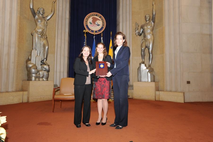 Helen Christodoulou, Caitlin Morrison, and Elizabeth Prewitt accept a 2011 Assistant Attorney General Team Award