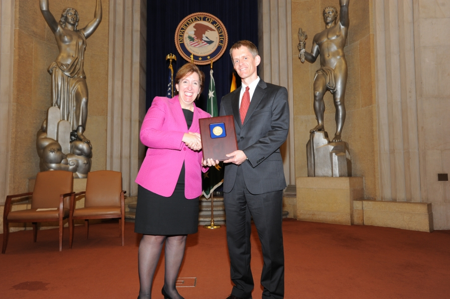 Acting Assistant Attorney General Sharis Pozen presents the 2011 Morrison Award to Jon Jacobs.