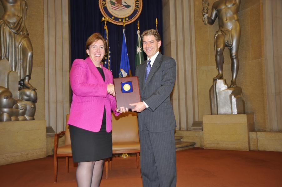Acting Assistant Attorney General Sharis Pozen presents a 2011 Assistant Attorney General Award to Mark Hamer.