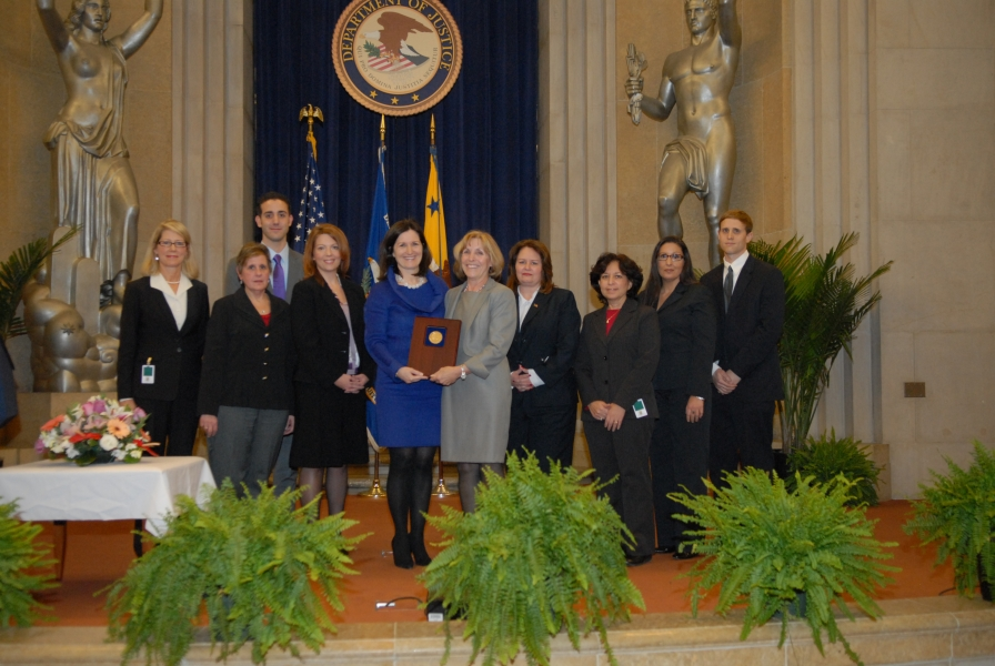AAG Christine Varney presents a 2010 AAG Team Award to the U.S. v. Norris Trial Team