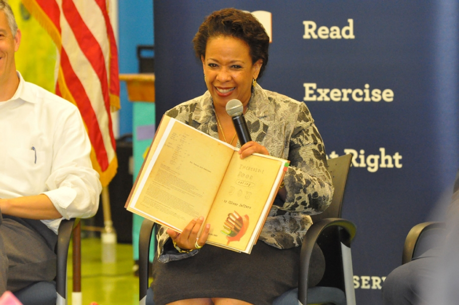 Attorney General Loretta E. Lynch reads to children at Seaton Elementary.