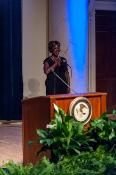 Rhea Walker, Special Assistant, Office of Justice Programs, sings the National Anthem at the 62nd Annual Attorney General's Awar