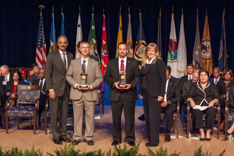 The Attorney General's Award for Excellence in Law Enforcement is presented to a team from the U.S. Marshals Service for its