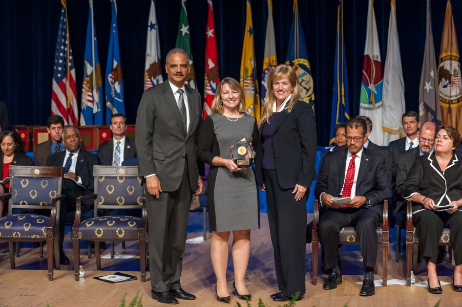 The Attorney General's Award for Excellence in Management is presented to Lisa Dickinson, U.S. Marshals Service (USMS), for her