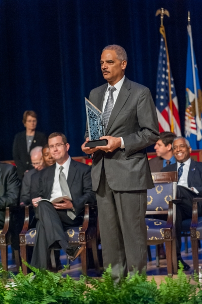 Attorney General Holder prepares to present The Attorney General's Award for Excellence in Information Technology.