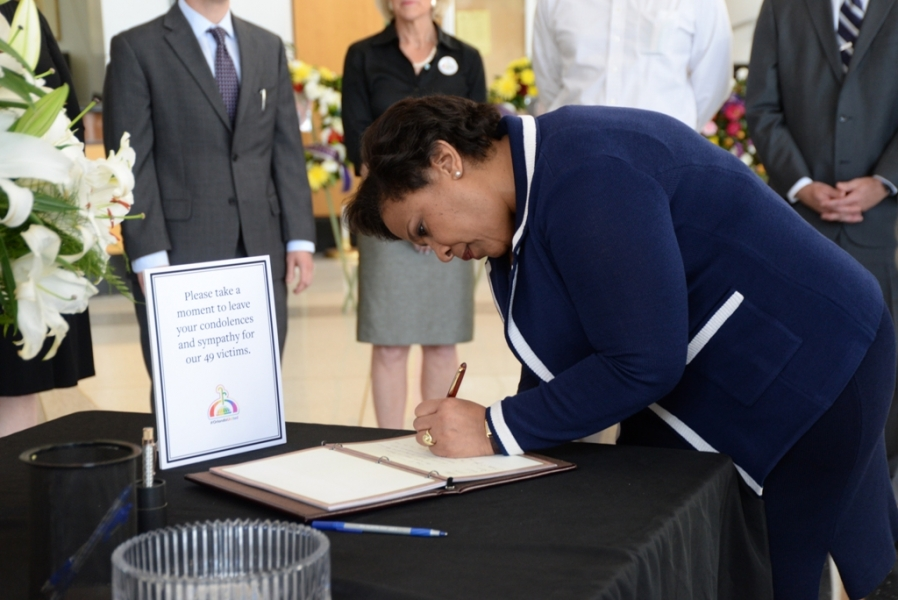 Attorney General Loretta E. Lynch signs guest book at Orlando City Hall memorial site.