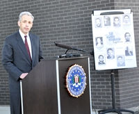 U.S. Attorney for the District of Colorado John Walsh speaking at a press conference announcing the addition of a fugitive to th