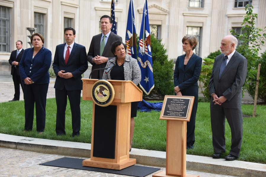 """Following a moment of silence, Attorney General delivered remarks and dedicated a commemorative plaque for the """"Survivor Tree"""""""