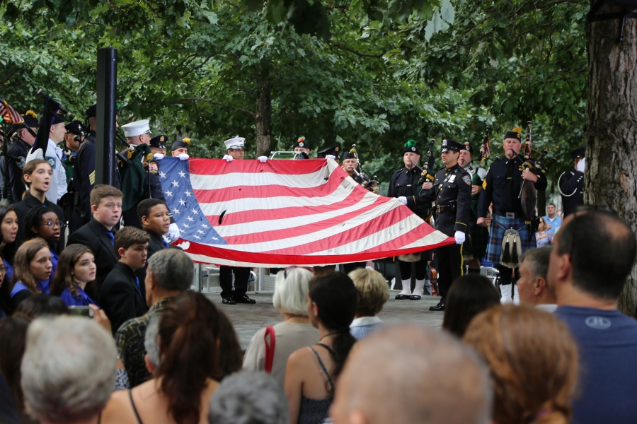 Soldiers present the American flag during the 15th anniversary ceremony at the National September 11 Memorial Plaza