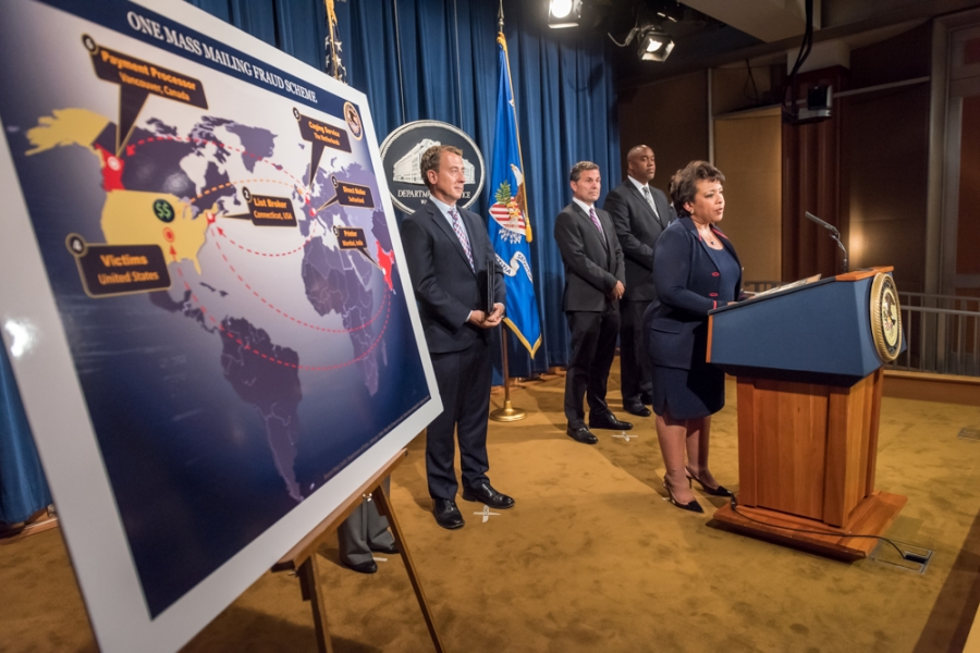 Attorney General Loretta E. Lynch and officials from U.S. Postal Inspection Service