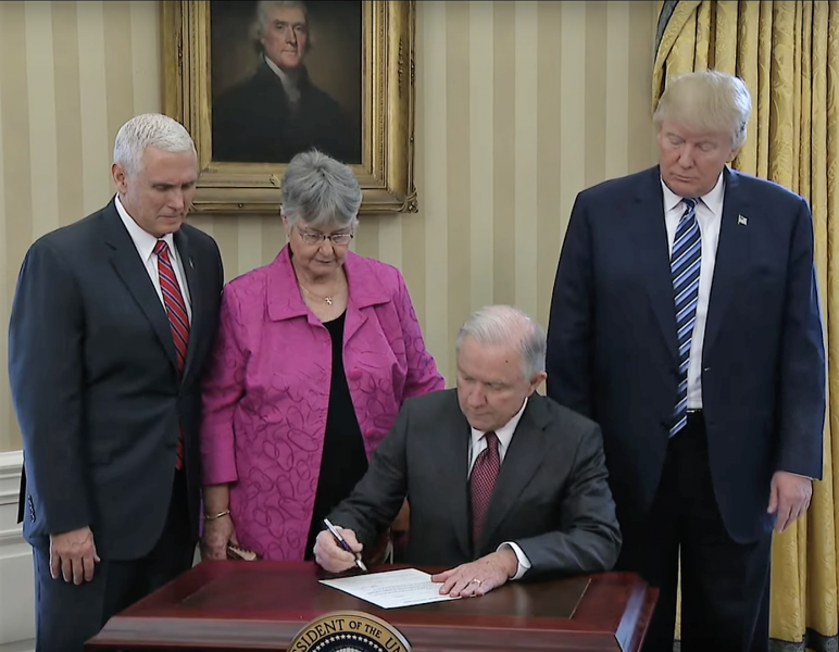 Attorney General Jeff Sessions signs his oath of office with President Trump, Vice President Pence, and his wife Mary.