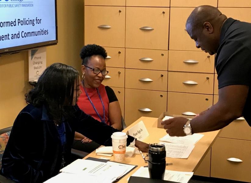 St. Petersburg College staff registers attendees.