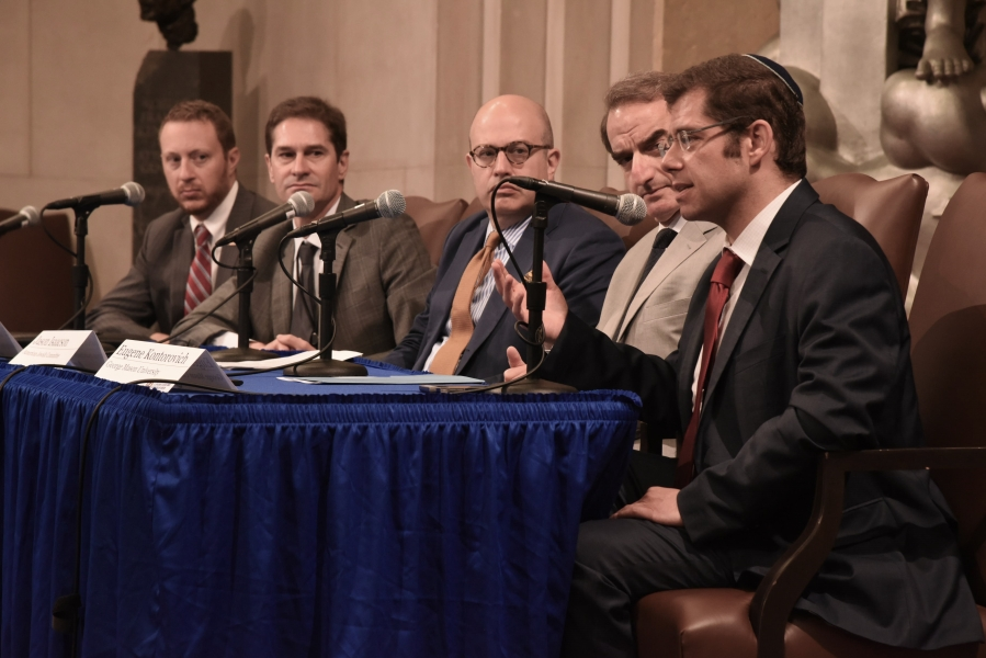 """Eli Lake, Columnist, Bloomberg View moderates a panel, """"Combatting Anti-Semitism While Respecting the First Amendment."""" Panelists include: Elliot Zweig, Deputy Director, Middle East Media Research Institute; Chris Hardee, Chief, Law and Policy Office, National Security Division; Daniel Elbaum, Chief Advocacy Officer, American Jewish Committee; and Eugene Kontorovich, Professor of Law, Antonin Scalia Law School, George Mason University."""