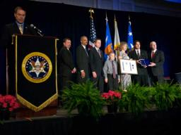 The family of Officer Stanley Cooper accepting the Fallen Hero Award and a U.S. Marshals Service Purple Heart Award.