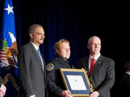 Chief Inspector Joel Kirch posing with AG Holder and Director Clark after receiving the Operational Employee of The Year Award.