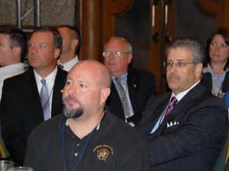 Conference participants listen attentively during the AG's address and pledge.