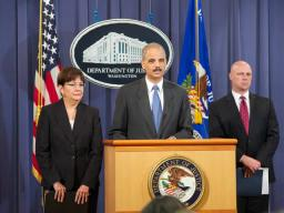 AGEric Holder flanked by U.S. Attorney Rosa Emilia Rodriguez-Velez, Puerto Rico and FBI Executive Assistant Director Shawn Henry