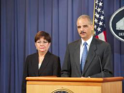 Attorney General Eric Holder flanked by U.S. Attorney Rosa Emilia Rodriguez-Velez, Puerto Rico