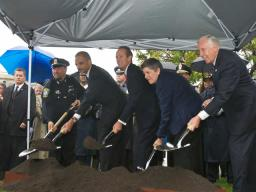 In a driving rain, Boston Police Officer Thomas Griffiths; Attorney General Eric Holder; Craig W. Floyd, chairman of National Law Enforcement Museum Memorial Fund; Homeland Security Secretary Janet Napolitano; and House Majority Leader Steny Hoyer (D-Md.) ceremonially shoveled dirt in an important step to make the museum a reality.