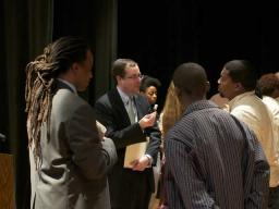 Associate Attorney General Tom Perrelli and Neil Irvin of Men Can Stop Rape talk with Benjamin Banneker students following the question and answer session.