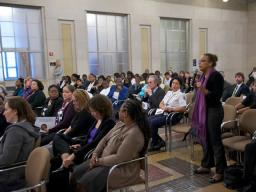 An audience member participates in the Domestic Violence Awareness Panel Discussion.