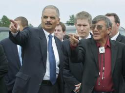 Attorney General Holder and President John Yellow Bird Steele of the Oglala Sioux Tribe at the Wounded Knee overlook.
