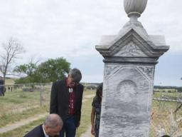 Attorney General Holder lays a wreath at the Wounded Knee Memorial Site