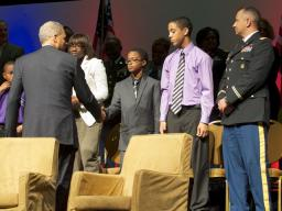 Attorney General Holder greets a military family in attendence.