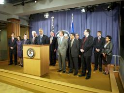 AG Eric Holder stands with HUD Secretary Shaun Donovan, Iowa AG Miller and other attending attorneys