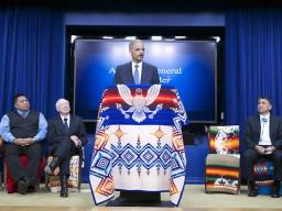 Attorney General Eric Holder (C) announces $1 billion settlement of Tribal Trust Accounting and Management lawsuits