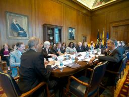 AG Holder speaks with agency representatives that attended the third federal interagency Reentry Council.