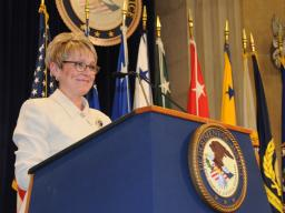 Melodee Hanes, Acting Administrator of the OJJDP, pauses during her opening address at the DOJ's National Missing Children's Day