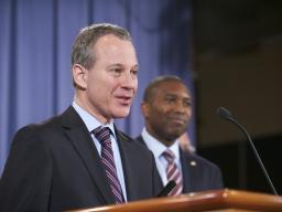 New York AG Eric Schneiderman, announces legal action against JPMorgan.