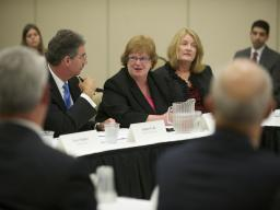 Deputy Attorney General James M. Cole listens intently during a panel discussion about IP theft.
