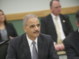 Attorney General Eric Holder takes in a discussion about IP theft at Towson University.