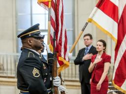 Guests stand for the National Anthem at the opening ceremony for the U.S. Department of Justice's Sunshine Week Celebration.