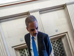 Attorney General Eric Holder views Clarence Gideon's handwritten petition.