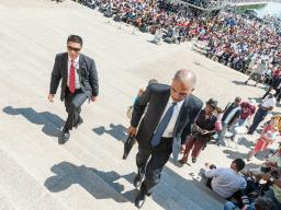 Attorney General Holder walks up the stairs of the Lincoln Memorial
