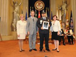 Detective Randall Abbott from the Hartford, Wisconsin Police Department receives the Missing Children's Law Enforcement Award.