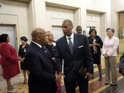 Mr. Ondray Harris and Congressman John Lewis shake hands.