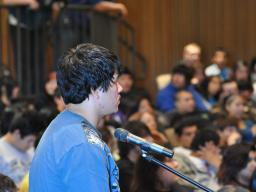 Standing Rock High School Students listen as classmate Jeremy Silva asks questions of Deputy Attorney General Cole..