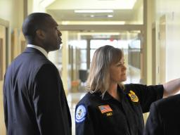 Acting Associate Attorney General Tony West listens to Kim Dahle, Administrator of the Juvenile Detention Facility.