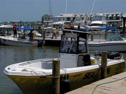 A photo of a few citizens and boats enlisted in helping with the oil spill clean as they prepare to launch.