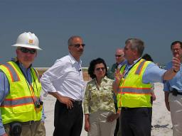 Officials directly involved with the clean up at West End Beach, Dauphin Island AL, explain their roles and current clean-up status to Attorney General Holder and Assistant Attorney General Moreno.