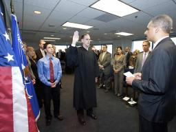 The Attorney General administers the oath of office.