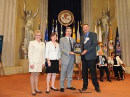 Special agent Tim Erickson of the North Dakota Bureau of Criminal Investigation receives the Attorney General's Special Commenda