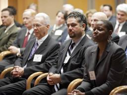 ICITAP managers from headquarters and South America listen to the Attorney General's remarks.