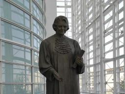 Statue of former Supreme Court Justice Sandra Day O'Connor within the court building bearing her name.